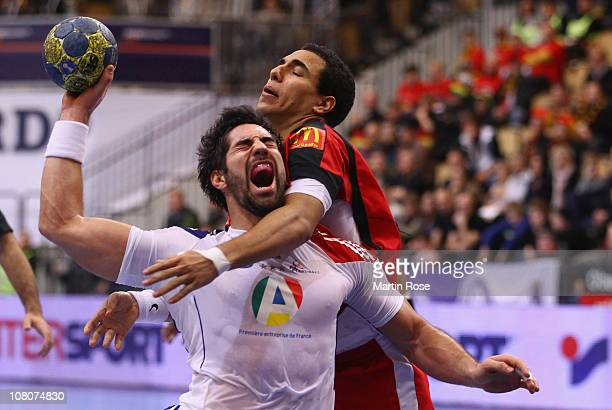 Amr El Kaioby of Egypt is challenged by Nikola Karabatic of France during the Men's Handball World Championship Group A match between Egypt and...