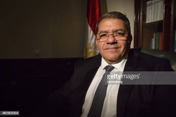 Amr ElGarhy Egypt's finance minister poses for a photograph following a Bloomberg Television interview in Cairo Egypt on Sunday April 29 2018 ElGarhy...
