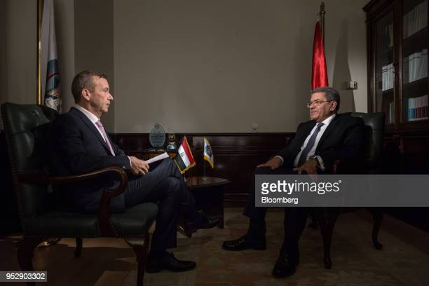 Amr ElGarhy Egypt's finance minister right speaks to Manus Cranny anchor for Bloomberg Television during a Bloomberg Television interview in Cairo...