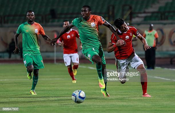 Amr Gamal of Al Ahly in action against Misheck Chaila of ZESCO United during the Group A match of CAF Champions League between Egyptian team Al Ahly...