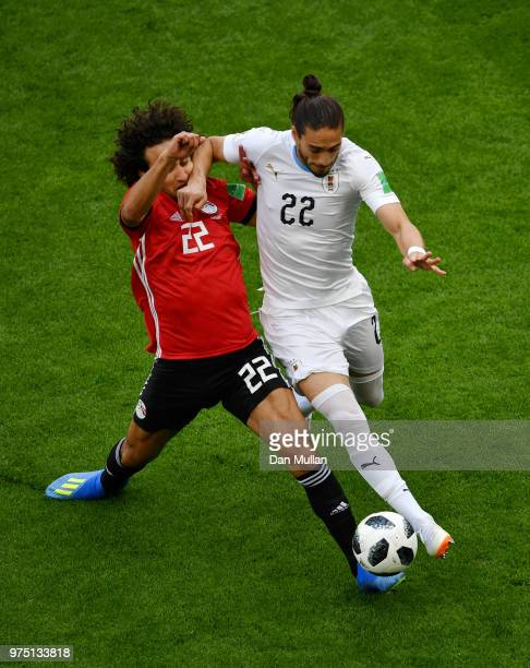 Amr Warda of Egypt and Martin Caceres of Uruguay battle for possession during the 2018 FIFA World Cup Russia group A match between Egypt and Uruguay...