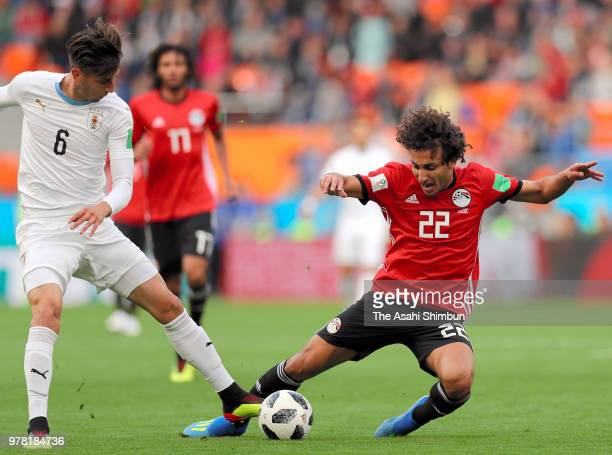 Amr Warda of Egypt and Rodrigo Bentancur of Uruguay compete for the ball during the 2018 FIFA World Cup Russia group A match between Egypt and...