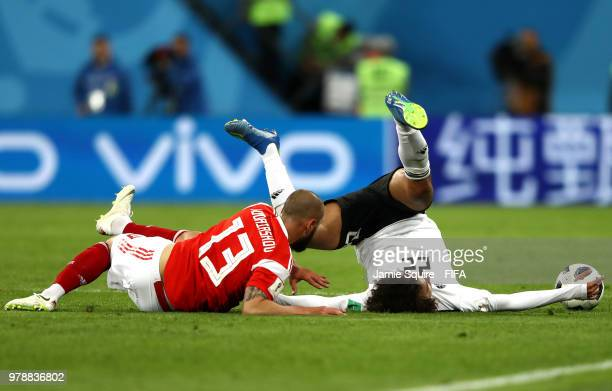 Amr Warda of Egypt clashes with Fedor Kudriashov of Russia during the 2018 FIFA World Cup Russia group A match between Russia and Egypt at Saint...