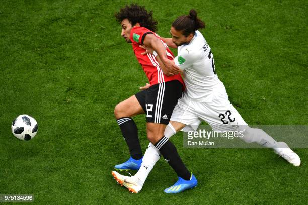 Amr Warda of Egypt is challenged by Martin Caceres of Uruguay during the 2018 FIFA World Cup Russia group A match between Egypt and Uruguay at...