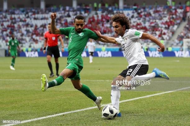 Amr Warda of Egypt looks to cross the ball under pressure from Mohammed Alburayk of Saudi Arabia during the 2018 FIFA World Cup Russia group A match...