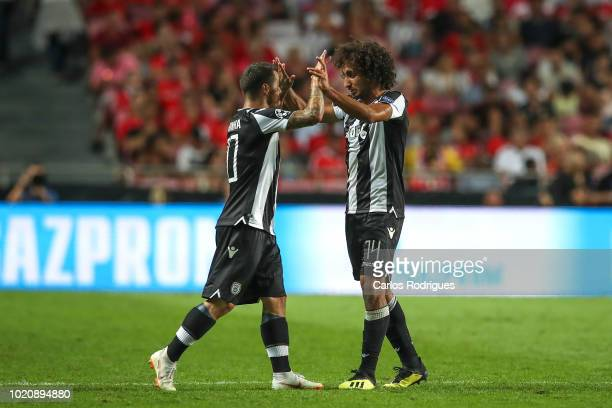 Amr Warda of PAOK celebrates scoring PAOK goal with Vieirinha of PAOK during the match between SL Benfica and PAOK for the UEFA Champions League Play...