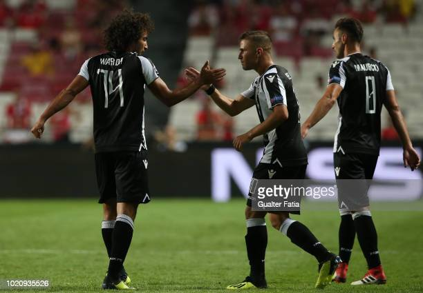 Amr Warda of PAOK celebrates with teammate Dimitris Peleas of PAOK after scoring a goal during the UEFA Champions League Play Off match between SL...