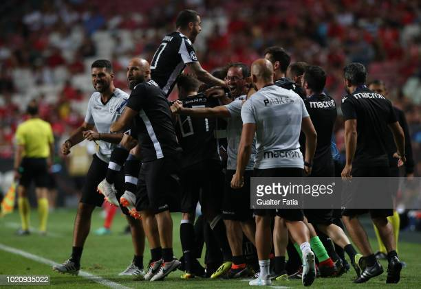 Amr Warda of PAOK celebrates with teammates after scoring a goal during the UEFA Champions League Play Off match between SL Benfica and PAOK at...