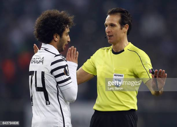 Amr Warda of PAOK discusses with referee Luca Banti during the UEFA Europa League Round of 32 second leg match between FC Schalke 04 and PAOK...