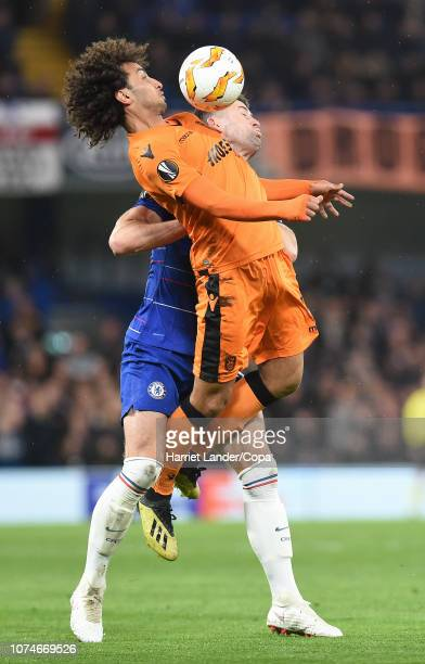 Amr Warda of PAOK FC competes for a header with Gary Cahill of Chelsea during the UEFA Europa League Group L match between Chelsea and PAOK at...