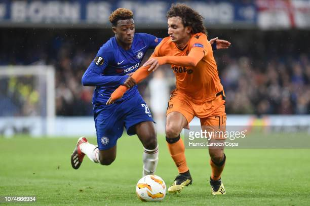 Amr Warda of PAOK FC is challenged by Callum HudsonOdoi of Chelsea during the UEFA Europa League Group L match between Chelsea and PAOK at Stamford...