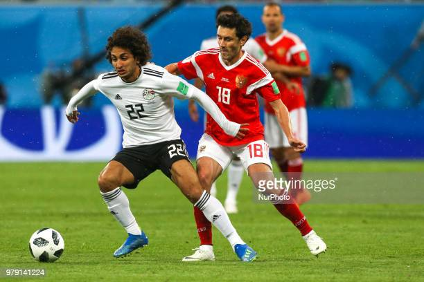 Amr Warda of the Egypt national football team and Yury Zhirkov of the Russia national football team vie for the ball during the 2018 FIFA World Cup...