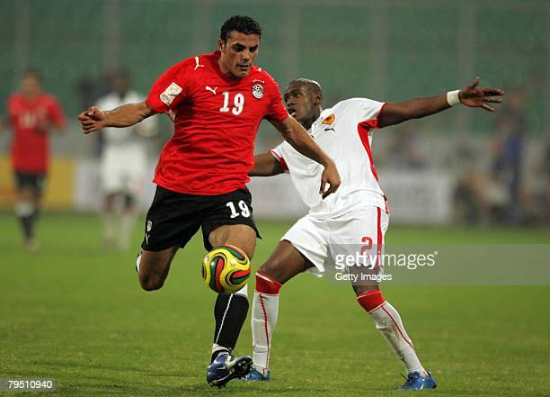 Amr Zaki of Egypt competes wirth and Marco Airosa of Angola during the AFCON Quarter final match between Egypt and Angola held at the Baba Yara...