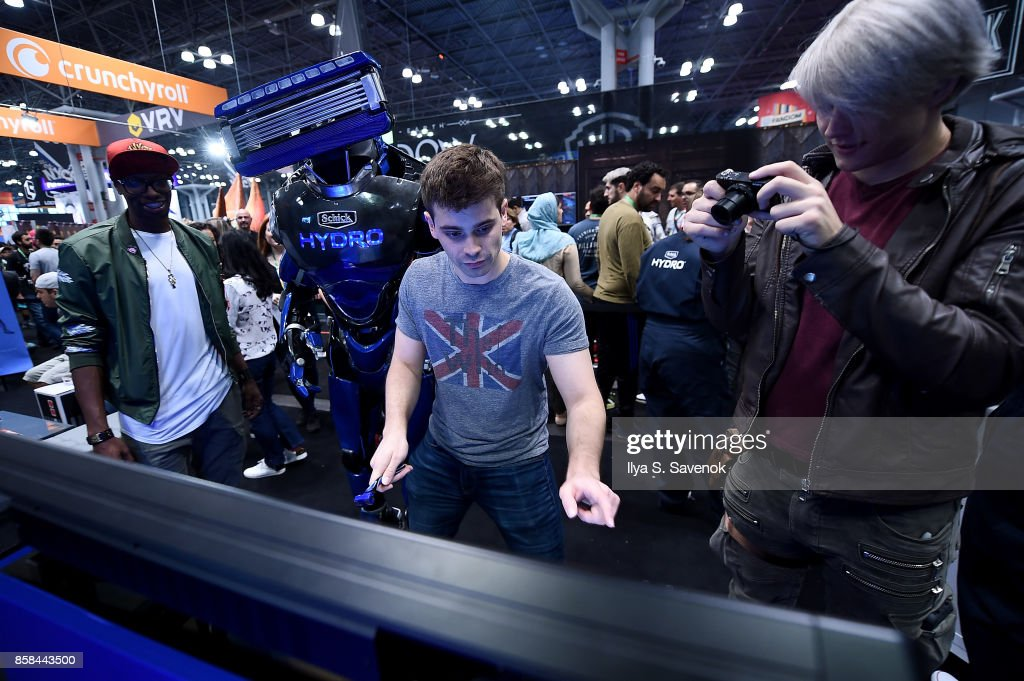 Amra 'Flitz' Ricketts, Damien Haas, and Wes Johnson of the Smosh Games crew play the 'Schick Shave Off' video game with Schick Hydro At New York Comic-Con 2017 on October 6, 2017 in New York City.