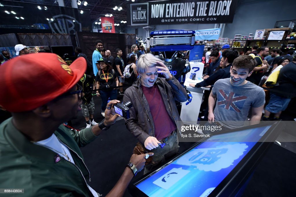 Amra 'Flitz' Ricketts, Wes Johnson, and Damien Haas of the Smosh Games crew play the 'Schick Shave Off' video game with Schick Hydro At New York Comic-Con 2017 on October 6, 2017 in New York City.