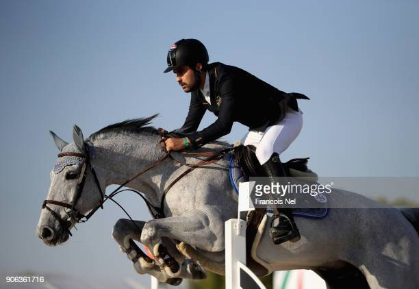 Amre Hamcho of Syria rides Al Murtajiz during the Dubai Show Jumping Championships on January 18 2018 in Dubai United Arab Emirates