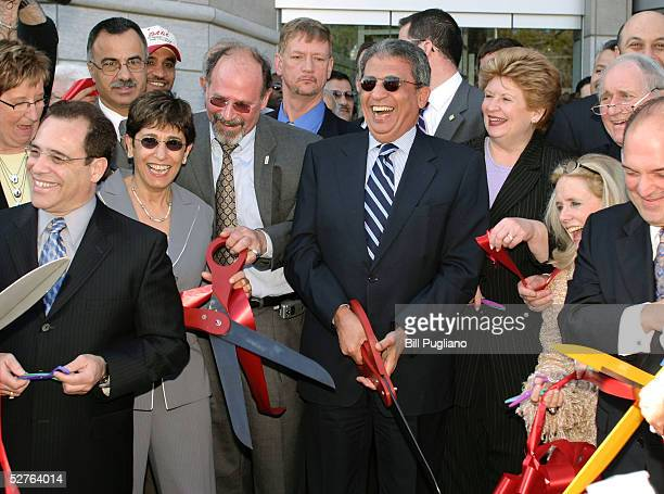 Amre Moussa Secretary General of the Arab League helps cut the ceremonial grand opening ribbon at the new Arab American National Museum May 5 2005 in...