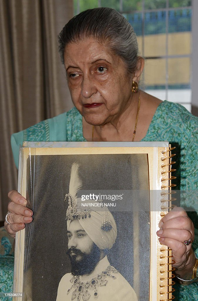 Amrit Kaur the daughter of the late Maharaja of Faridkot Harinder Singh Brar poses with a portrait of the Maharaja at her residence in Chandigarh on..