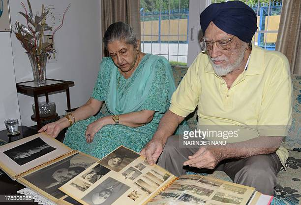 Amrit Kaur the daughter of the late Maharaja of Faridkot Harinder Singh Brar and her husband Harpal Singh look through photograph albums at their...