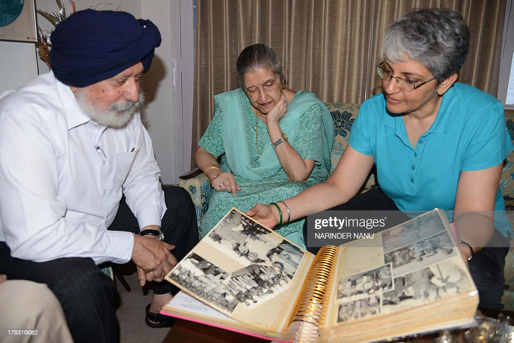 Amrit Kaur the daughter of the late Maharaja of Faridkot Harinder Singh Brar looks on as her daughter Gurveen and lawyer Manjit Singh Khaira leaf...