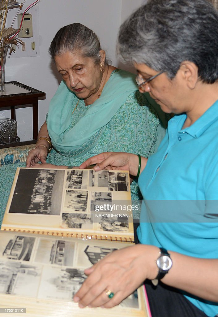 Amrit Kaur the daughter of the late Maharaja of Faridkot Harinder Singh Brar looks on as her daughter Gurveen leafs through photograph albums at her..