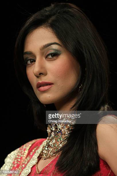 Amrita Rao walks the runway in a Agni Jewellery design at the India International Jewellery Week 2012 Day 2 at the Grand Hyatt on on August 20 2012...