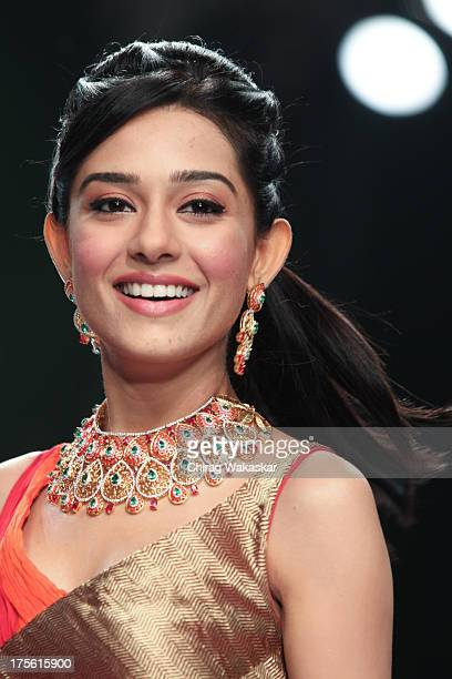 Amrita Rao walks the runway in an Agni Jewels design on day 1 of India International Jewellery Week 2013 at the Hotel Grand Hyatt on August 4 2013 in...