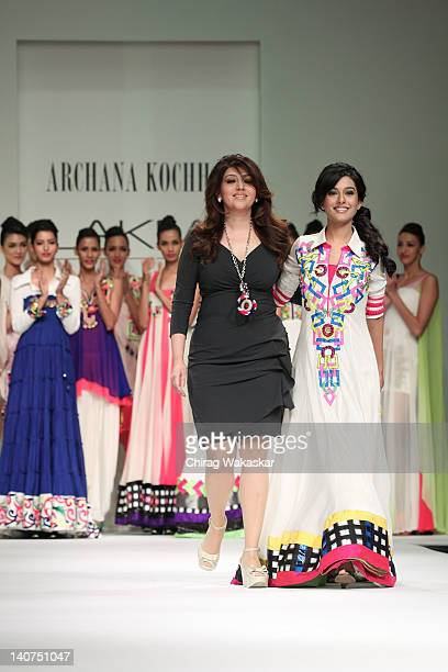 Amrita Rao walks the runway with designer Archana Kochhar at Lakme Fashion Week Summer/Resort 2012 day 5 at the Grand Hyatt on March 6 2012 in Mumbai...