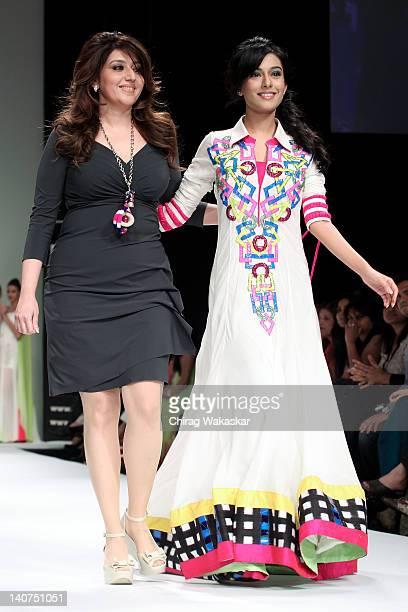 Amrita Rao walks the runway with designer Archana Kochhar at Lakme Fashion Week Summer/Resort 2012 day 5 at the Grand Hyatt on March 6 2012 in Mumbai...