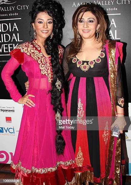 Amrita Rao with designer Archana Kochchar during the Bridal fashion week in Mumbai on November 2 2010