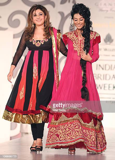 Amrita Rao with designer Archana Kochchar during the Bridal fashion week in Mumbai on November 2 2010