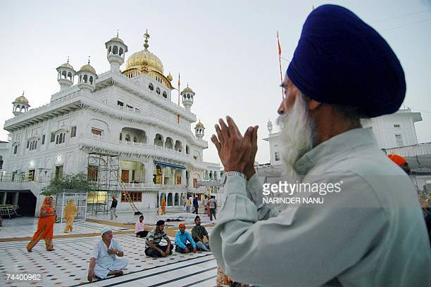 An Indian Sikh devotee offers prayers at the Golden Temple in Amritsar, 05 June 2007, on the eve of the 23rd Anniversary of Operation Bluestar. The...