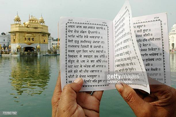 An Indian Sikh devotee reads the holy book of the Sikhs at the Golden temple on the occasion of Bandi Chhor Divas in Amritsar 21 October 2006...