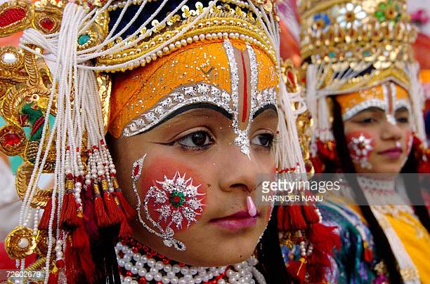 Indian children dressed as Hindu deities Lord Ram and Lakshman take part in a procession to commemerate the birth anniversary of Shri Madhavrao...