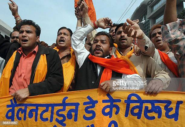 Indian Shiv Sena activists shout slogans as they march during a protest against Valentine's Day in Amritsar13 February 2006 Hindu nationalists...