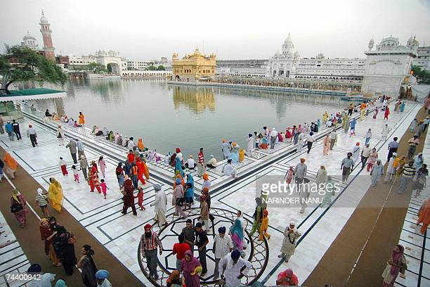 Indian Sikh devotees gather at the Golden Temple in Amritsar, 05 June 2007, on the eve of the 23rd Anniversary of Operation Bluestar. The assault on...