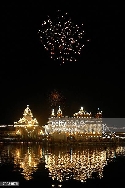Indian Sikh devotees watch a fireworks display above the illuminated Golden temple in Amritsar on the occasion of Bandi Chhor Divas in Amritsar 21...