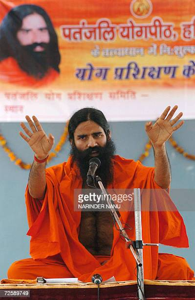 Indian Yoga Guru Swami Ramdev gestures as he addresses prisoners at The Central Jail in Amritsar17 November 2006 Hundreds of prisoners took part in a...