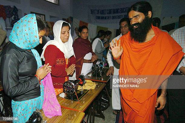 Indian Yoga Guru Swami Ramdev gestures as he meets with female prisoners at The Central Jail in Amritsar17 November 2006 Hundreds of prisoners took...