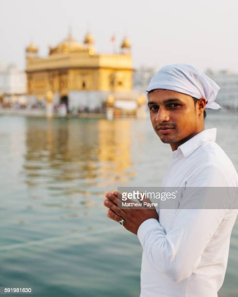 Amritsar, India: Portrait of young Sikh man in front of Golden Temple