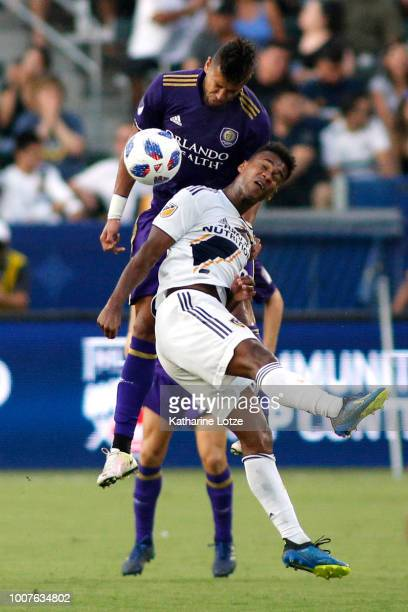 Amro Tarek of Orlando City SC and Ola Kamara of the Los Angeles Galaxy fight for control of the ball at StubHub Center on July 29 2018 in Carson...