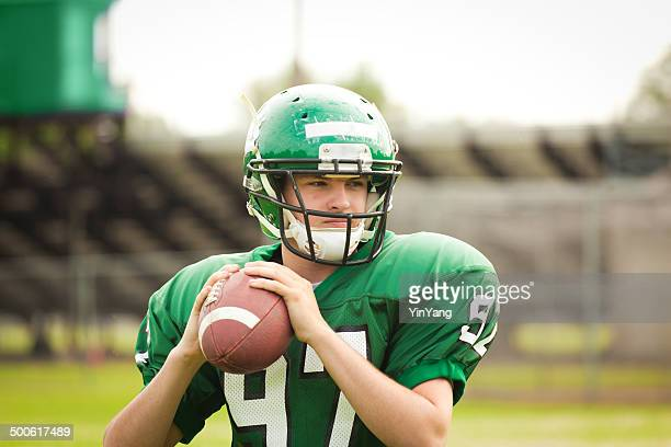 amrtican football player quarterback throwing a pass close-up - high school football stock pictures, royalty-free photos & images