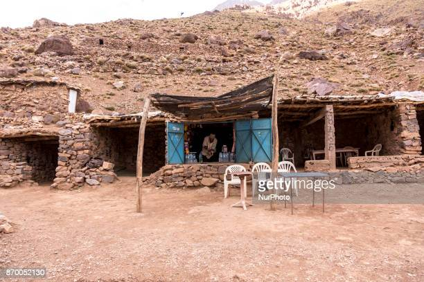 Berber man in his small shop in a very remote place by lake Ifni in high Atlas mountains