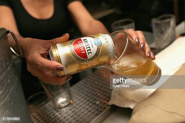 Amstel Light Lager Beer being prepared at the Grilled Cheese Happy Hour Hosted By Laura Werlin And Ms Cheezious during 2016 Food Network Cooking...