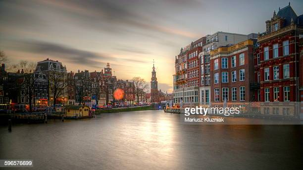 Amstel river and Munttoren Amsterdam sunset view