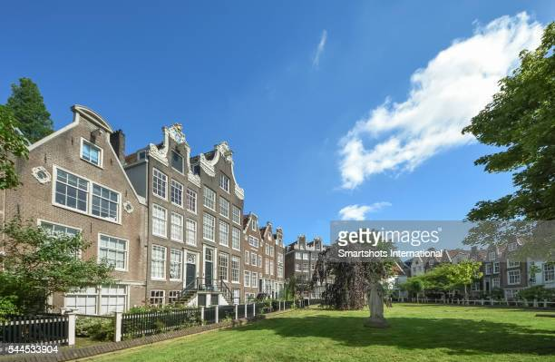 Amsterdam beguinage, a beautiful courtyard with 17th and 18th century houses in old town Amsterdam, the Netherlands