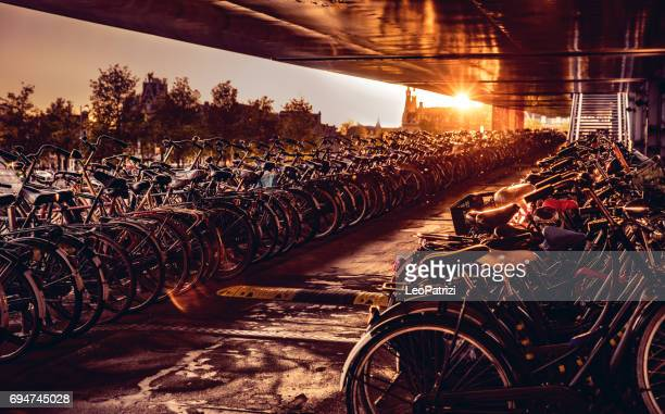 amsterdam bicycle parking at central railway station - bicycle parking station stock photos and pictures