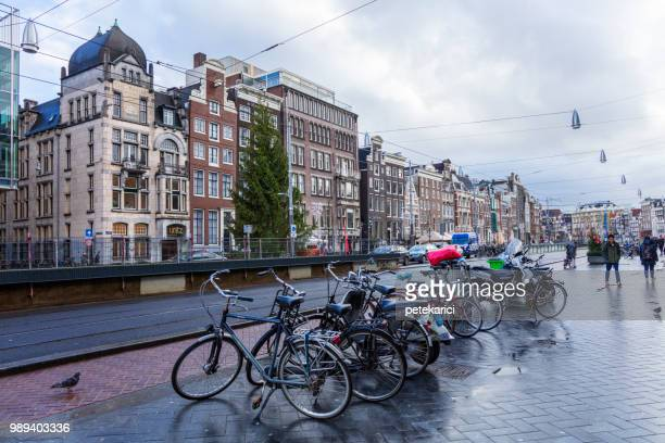amsterdam: bicycle parking - bicycle parking station stock photos and pictures