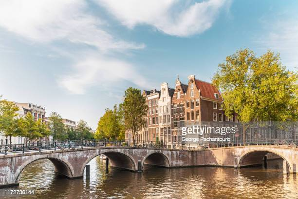 amsterdam bridge and houses - amsterdam stock pictures, royalty-free photos & images