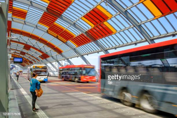 Amsterdam bus station with busses arriving and departing
